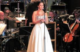 Girl in white dress singing at the Maryland Symphony Orchestra